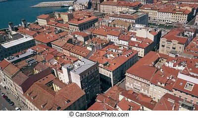 Aerial view of old buildings and streets in Trieste, Italy -...