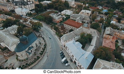 Aerial view of old city center with old houses and town hall.