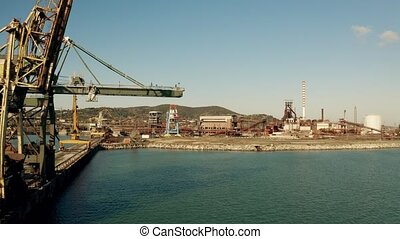 Aerial view of old seaport cranes on the pier - Aerial shot...
