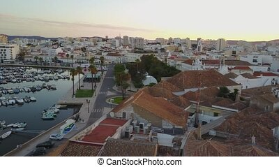Aerial view of old town, modern architecture, marina and...