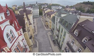 Aerial view of old town streets with building roofs