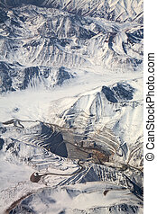 aerial view of open-pit mine under snow in Atacama desert, Chile