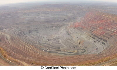 Aerial view of opencast mining quarry with lots of machinery...