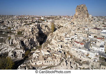 Aerial view of Ortahisar town old houses in rock formations.