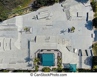 Aerial view of outdoor empty concrete skate park with ramps