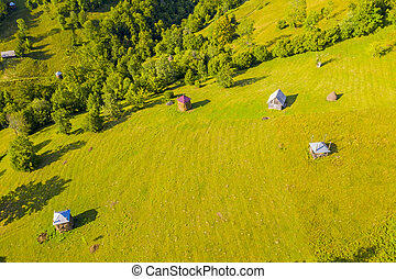Aerial view of pasture and haystacks