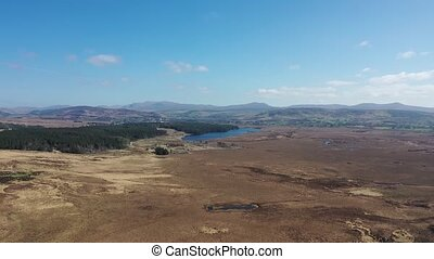 Aerial view of peatbog and Lake Ananima next to the town Glenties in County Donegal - Ireland