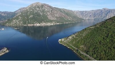 Aerial view of Perast town in Kotor bay in summer sunny...