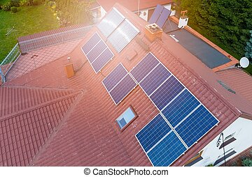 Aerial view of photovoltaic solar panels on house roof