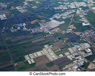 Aerial view of Phrae city from airbus twin propeller takeoff from Phrae Airport flying go to Bangkok, Thailand