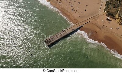 Aerial view of pier and beach in Albufeira, Portugal