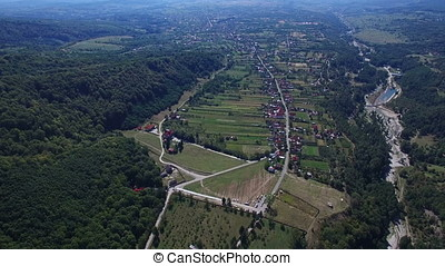 Aerial view of Polovragi commune and Monastery, Romania