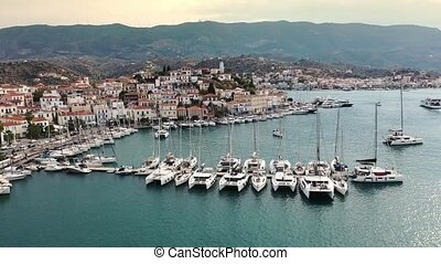 Aerial view of Poros old town and marina or seaport, Greece - drone videography. High quality 4k footage