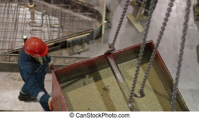 Aerial view of Pouring concrete mix on concreting formwork -...