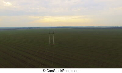 Aerial view of power lines and green field