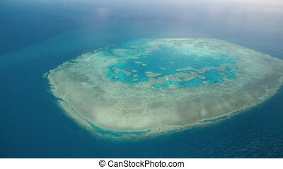 Aerial view of Queensland Coral Reef Island from a flying airplane.