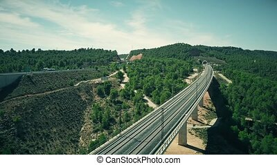 Aerial view of railroad bridge and tunnel in Spain - Aerial...