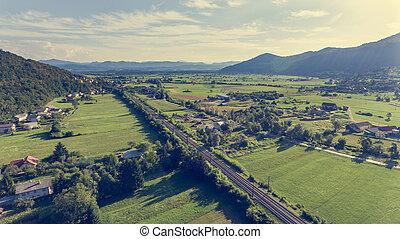 Aerial view of railroad running through fields.