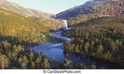 Aerial view of Rapid Stunning Waterfall in Husedalen Valley,...