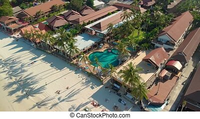 Aerial view of resort with pool on the tropical beach