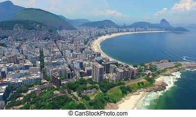 Aerial view of Rio de Janeiro and the Atlantic Ocean with mountains. Shevelev.