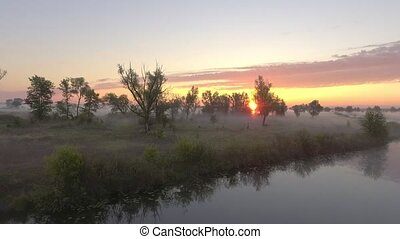 aerial view of river at sunrise, fly over morning mist on the river