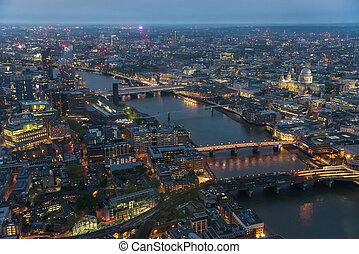 Aerial view of river Thames in London at dusk