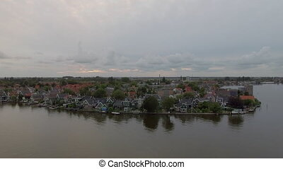 Aerial view of riverside township in Netherlands