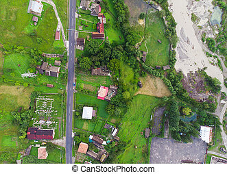 aerial view of road and village in Romania