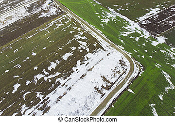 aerial view of road in meadow from the drone