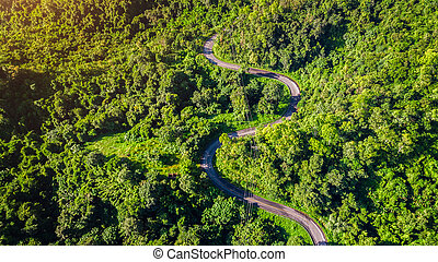 Aerial view of road in mountains.