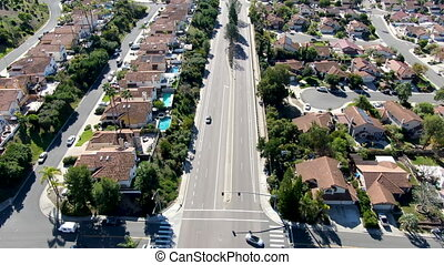 Aerial view of road in typical suburban neighborhood with big villas next to each other, San Diego