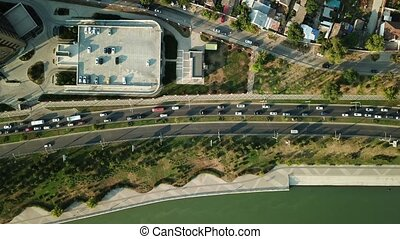 Aerial view of road traffic with cars on the city road -...