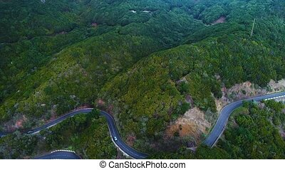 road winding in mountains - aerial view of road winding in...