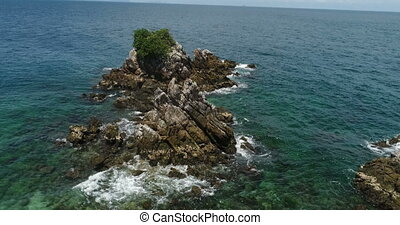 Aerial view of rocks in the sea
