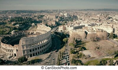 Aerial view of Roman cityscape involving famous Colosseum...