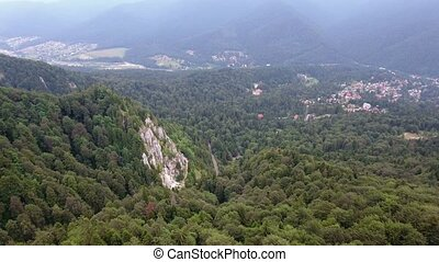 Aerial view of Romania mountains landscape town valley scenery