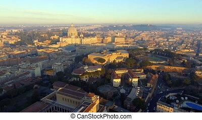 Rome skyline cityscape with Vatican City landmark at sunrise...