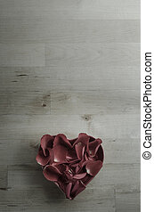 Aerial View of Rose Petals in Heart Shaped Bowl on Wood -...
