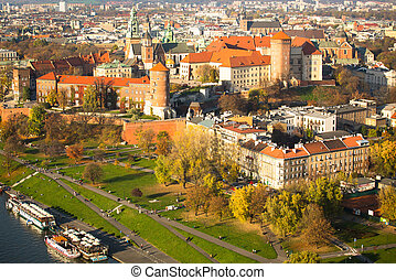 Aerial view of Royal Wawel castle with park and Vistula river in Krakow, Poland.