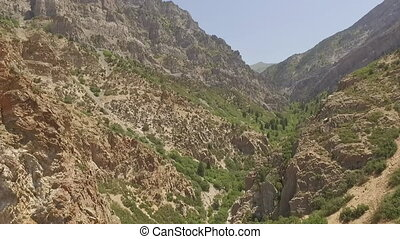 Aerial view of rugged and rocky terrain in the mountains