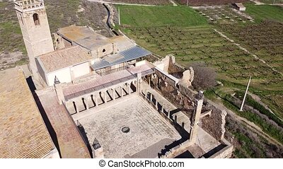 Aerial view of ruins of medieval monastery of Our Lady of Angels of Avinganya, Seros, Catalonia, Spain.