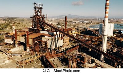Aerial view of rusty equipment of an obsolete industrial...