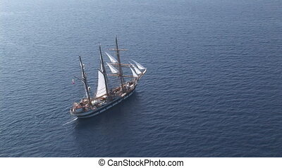 Aerial view of sailing ship at sea