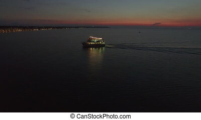 Aerial view of sailing touristic ship at night