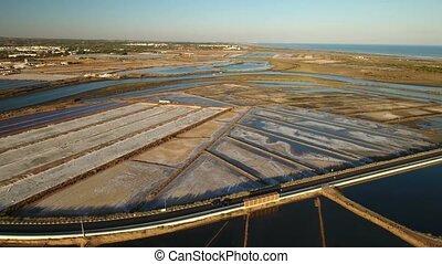 Aerial. View of salt lakes on Ria Formosa in Tavira