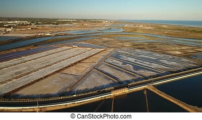 Aerial. View of salt lakes on Ria Formosa in Tavira