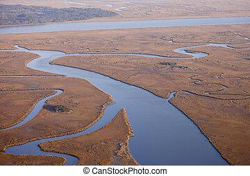 aerial view of salt marsh - aerial view of marine estuary in...