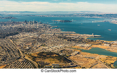 Aerial view of San Francisco wide area with bay and bridges