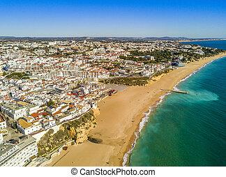 Aerial view of sandy Fishermen Beach in Albufeira, Algarve, Portugal